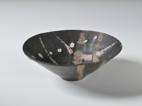 Mid 1980's. Manganese, wax resist, pink and white slip decoration. Reduction fired, cone 9