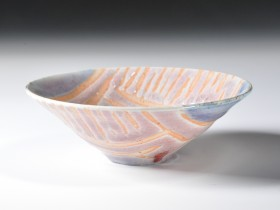 1986. Wax resist decoration, copper-red glaze. Reduction fired. Cone 9