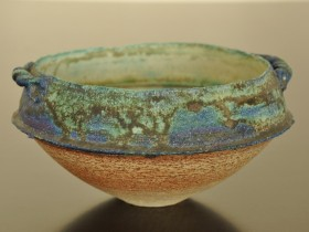 Late 80's/early 90's. Barium and copper glazes. Heavily grogged (molochite) white stoneware bowl with handles.