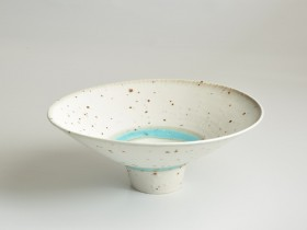 Grogged porcelain bowl 24.5cm diameter.